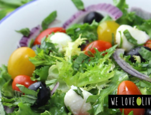 MEDITERRANEAN SALAD WITH CHERRYS, BLACK OLIVES, MOZZARELLA AND BASIL.